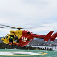 Westpac Rescue helicopter conducting a landing to test spring supports of the helipad during verification testing.