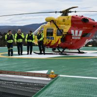 Westpac Rescue helicopter crew disembarked and walking inside to inspect the helipad foyer. From left to right, Garry White (Ambulance Tasmania), Peter McKenzie (Rotorlift Pilot), Dave Davies (Rotorlift Co-Pilot) and Rod Stacey (Tasmania Police)