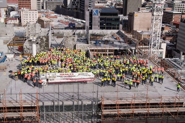Top of K Block.  Construction workers in safety hats and vests.